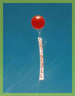 8ft. helium advertising balloon with vertical banner for more visibility. Advertising balloons are a cost effective means to generate traffic, FAST!